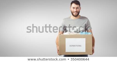 Heureux homme vêtements africaine contribution boîte Photo stock © AndreyPopov