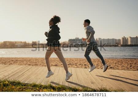 Mutlu kız çalışma şehir sokak sahil genç atlet Stok fotoğraf © blasbike