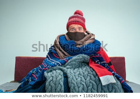 Krank Mann bedeckt Decke Sitzung Stock foto © AndreyPopov