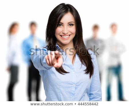 feliz · mulher · jovem · indicação · dedo · gesto · emoções - foto stock © minervastock