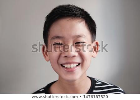 pre teen boy at school stock photo © lopolo