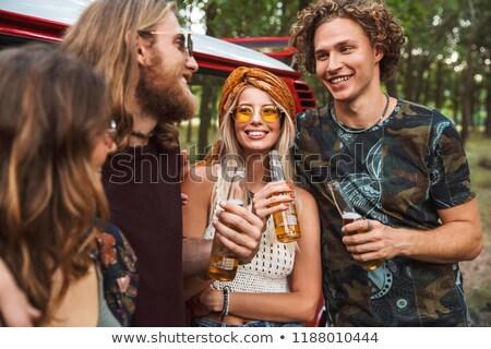 Groupe séduisant hippies hommes femmes souriant Photo stock © deandrobot