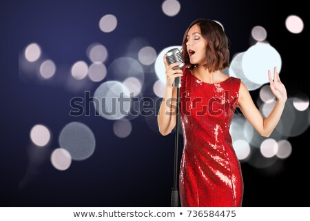 Kobieta czerwona sukienka śpiewu szczęśliwy włosy mikrofon Zdjęcia stock © Elnur