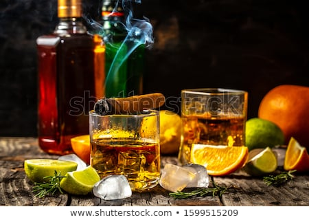 alcoholic with bottle drinking whiskey at home Stock photo © dolgachov