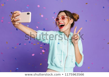 Portrait of a joyful young girl with bright makeup Stock photo © deandrobot