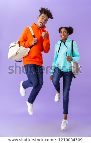 Full length photo of teen african american couple in colorful cl Stock photo © deandrobot