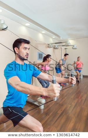 Jonge man weerstand anker gymnasium portret Stockfoto © Kzenon