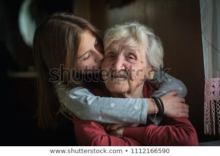 grandmother and granddaughter on white portrait happy family co stock photo © dashapetrenko