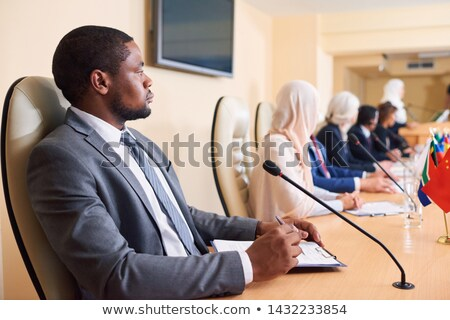Confident young African-american delegate in formalwear Stock photo © pressmaster