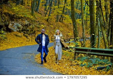 Fashionable beautiful young girlfriends walking together in the  Stock photo © dashapetrenko