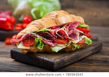 Sandwich with salami on the wooden board Stock photo © Alex9500