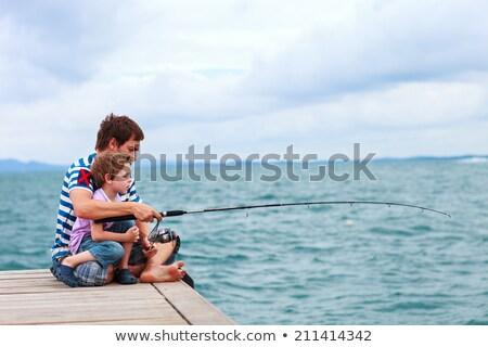 Padre piccolo figlio pesca shore fiume Foto d'archivio © dashapetrenko