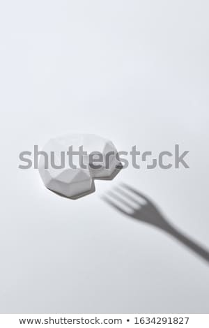 White plaster heart with hard shadow from fork. Stock photo © artjazz