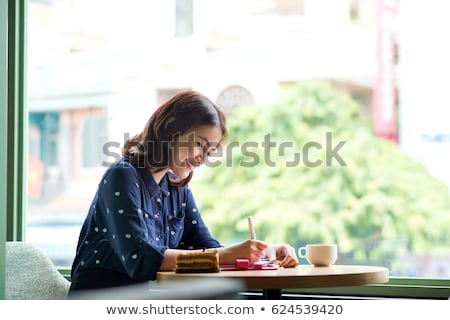 Diák nő napló notebook gondolkodik oktatás Stock fotó © dolgachov