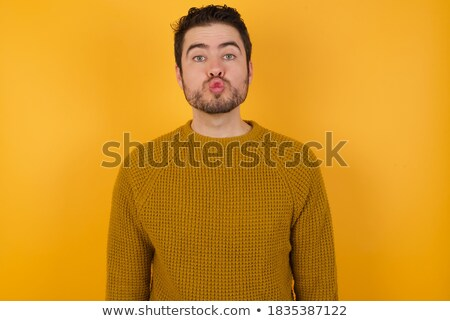 Photo of attractive young European male with pleasant appearance, wears warm fut hat, transparent gl Stock photo © vkstudio