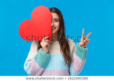 Waist up portrait of happy brunette young female shows peace sign, smiles happily at camera, wears b Stock photo © vkstudio