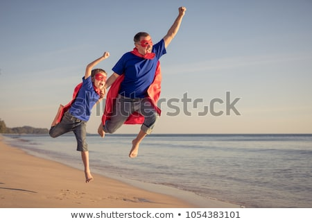 Father and son playing superhero at the day time. Stock photo © altanaka