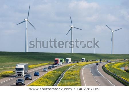 Windturbines near a motorway Stock photo © Hofmeester
