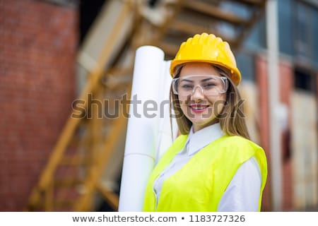 young architect woman wearing a protective helmet standing stock photo © dacasdo