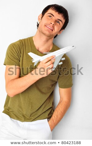 Closeup portrait of handsome caucasian man holding aircraft at h Stock photo © HASLOO