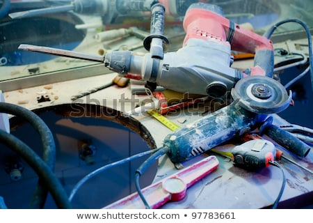 home improvement  messy clutter with dusted tools stock photo © lunamarina