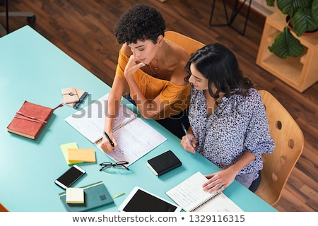 Two women studying together in the library Stock photo © photography33