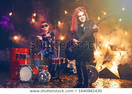 Kids pretending to be in a rock band Stock photo © photography33