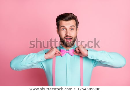 Portrait of funny fashion men in suspender with bow tie and glas Stock photo © Massonforstock