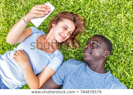 couple laying in the park with laptop stock photo © photography33