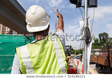 surveyor taking readings on construction site stock photo © photography33