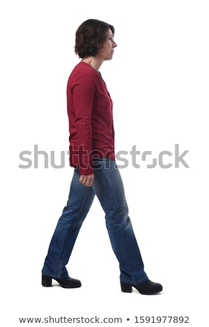 Attractive female standing sideways and smiling Stock photo © stockyimages