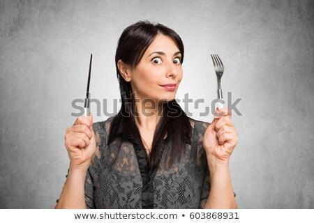 woman holding a knife stock photo © wavebreak_media