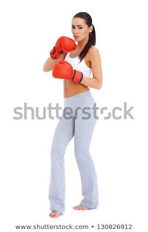 full body shot of a woman wearing boxing gloves stock photo © dash