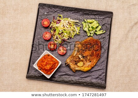 Delicious barbecued pork meal on table setting Stock photo © jarenwicklund