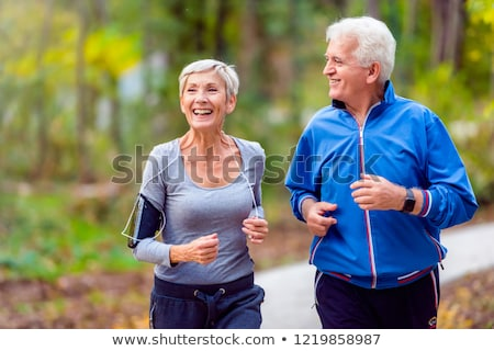Ouderen paar jogging vrouw man lopen Stockfoto © photography33