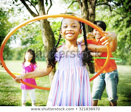 Little girl playing with hula hoop Stock photo © doupix
