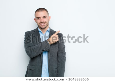 young business executive pointing upwards stock photo © stockyimages