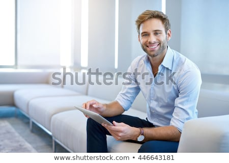 Jeunes homme d'affaires caméra posant mur de briques Photo stock © feedough
