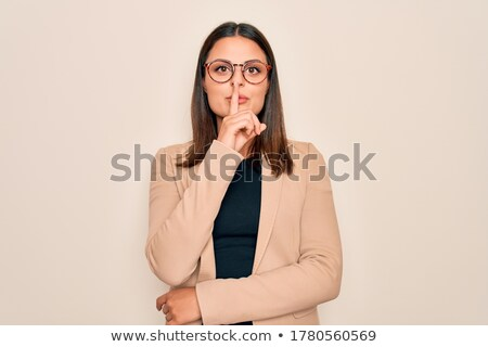 молодые брюнетка деловая женщина очки знак тихий Сток-фото © sebastiangauert