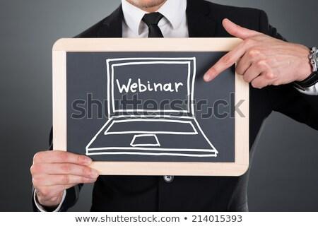 Webinar üzletember tart iskolatábla cici üzlet Stock fotó © stevanovicigor
