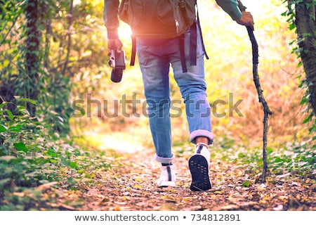 Young Man Outdoors Walking In Autumn Woodland Holding Walking St Stock photo © monkey_business