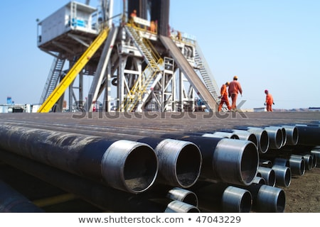 oil workers on land drilling rig stock photo © goce