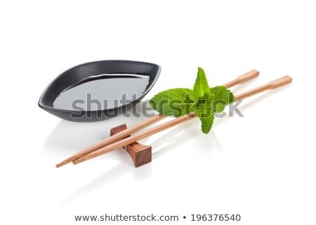 Sushi Çin yemek çubukları nane yaprakları yalıtılmış beyaz Stok fotoğraf © karandaev