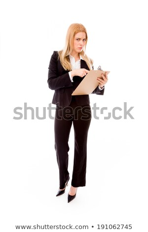 Businesswoman holding a clipboard and staring toward camera Stock photo © bmonteny