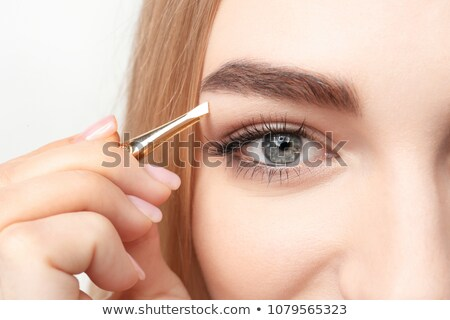 Woman remove eyebrows by tweezers stock photo © CandyboxPhoto