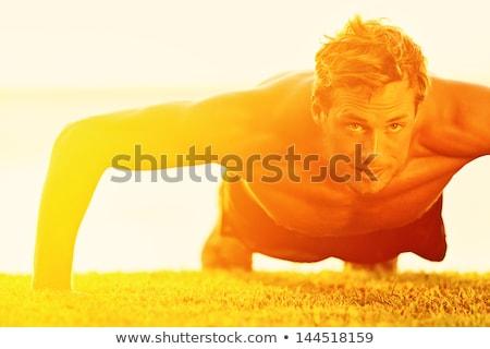 Push-ups crossfit man fitness training on beach Stock photo © Maridav