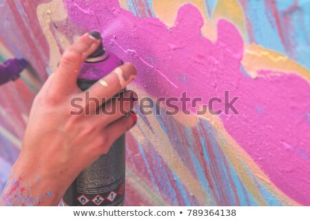 aerosol spray paint in his hand  Stock photo © OleksandrO