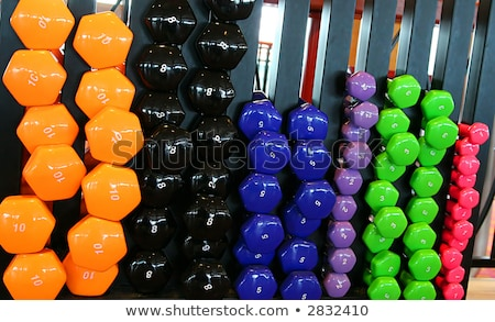 heavy black dumbbells on rack in weights room stock photo © wavebreak_media