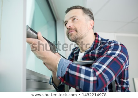 Person Applying Silicone Sealant Stock photo © AndreyPopov