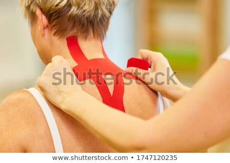 doctor gets tapes on patient back Stock photo © Flareimage